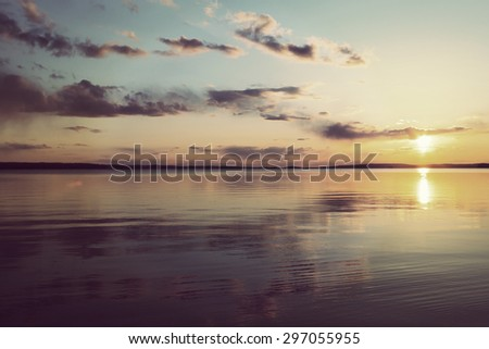 Amazing landscape scenery during sunset in Finland. Image has a vintage effect applied. - stock photo