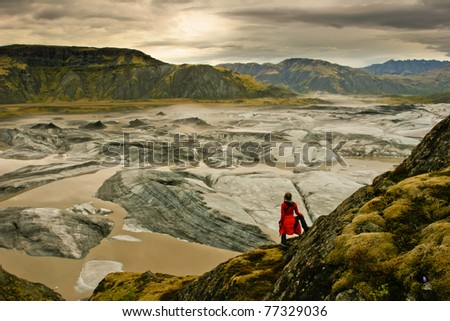 Amazing landscape scenery with a floating iceberg in the foreground and a glacier in the background, Vatnajokull, Iceland - stock photo