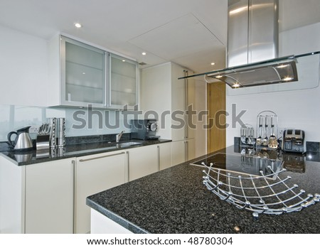 amazing luxury kitchen with modern electric appliances - stock photo