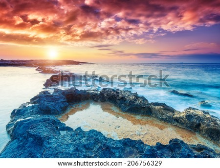 Amazing morning sun over the sea. Dramatic scenery. Volcanic island of Malta. Qawra, Europe. Beauty world.