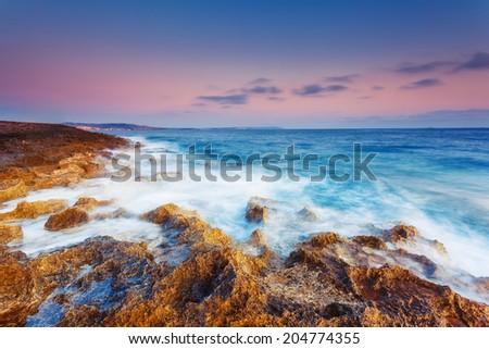 Amazing morning sun over the sea. Volcanic island of Malta. Qawra, Europe. Beauty world. Retro toning effect. - stock photo