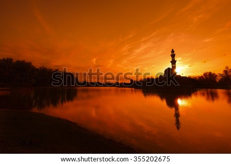 Amazing mosque silhouette during sunset moment - stock photo