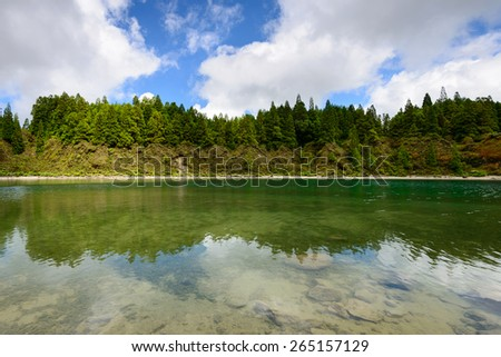 Amazing natural landscape. Lagoa do Fogo is located in a volcanic crater on the island of Sao Miguel, Azores. Considered one of the wonders of Portugal, for its stunning scenery and its wild beach. - stock photo
