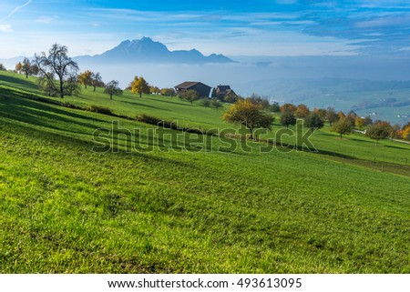 Amazing Panorama of Mount Pilatus and Lake Lucerne covered with frog, Alps, Switzerland