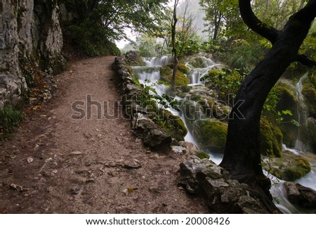 Amazing path beside a waterfall in Plitvice National Park, Croatia.