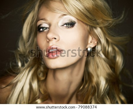 Amazing portrait of beautiful young blond woman. Close-up face studio photo. - stock photo