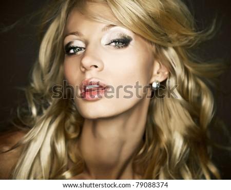 Amazing portrait of beautiful young blond woman. Close-up face studio photo. - stock photo