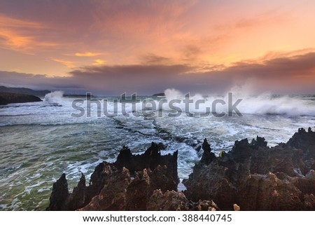 Amazing power of waves crashing against the rocks at dawn