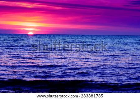 Amazing purple sunset over sea  - stock photo