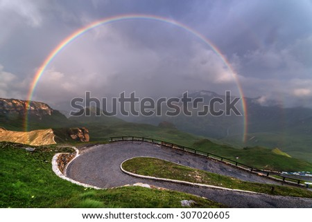 Amazing rainbow on the top of grossglockner pass, Alps, Switzerland, Europe. - stock photo