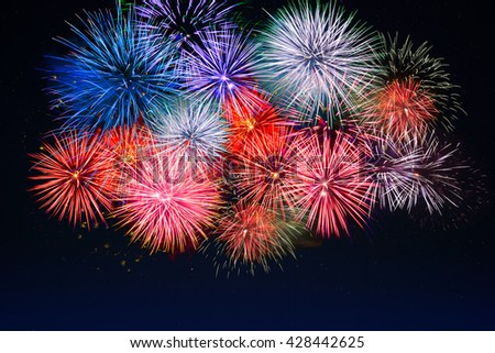 Amazing red, golden, blue fireworks. Celebration beautiful colorful fireworks. Holidays salute of various colors on night sky. 4 of July.  4th of July. Independence Day. New Year. Beautiful fireworks. - stock photo
