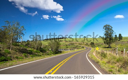 Amazing road with clouds and the rainbow - stock photo