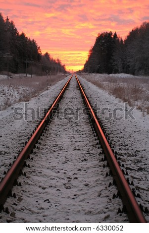 Amazing rural winter scene in sunset with railroad - stock photo