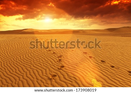 Amazing scene in Sahara desert before sandstorm. Pattern in the desert, Sahara - Tunisia. Visible large-scale structure of the sand! Vibrant Color. Lens flare. - stock photo