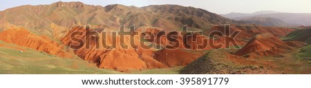 Amazing scenic orange hills panoramic view, screes of sandstone, sides carved away by erosion, canyon Uchterek, Kyrgyzstan, Central Asia. - stock photo