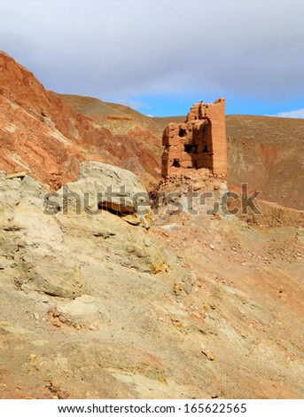 Amazing scenic view - lonely ruined tower of ancient Basgo fortress against the background of rugged mountain range and blue sky, Leh district, Ladakh, Himalaya, Jammu & Kashmir, Northern India  - stock photo