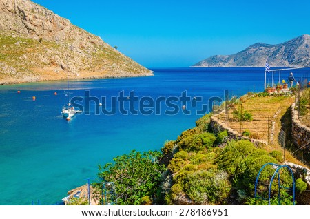 Amazing sea bay on Greek Island with yacht on anchor, Greece - stock photo