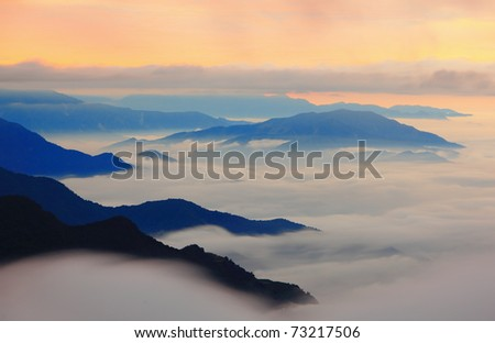 amazing sea of clouds with sunset - stock photo