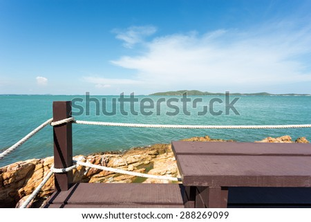 Amazing sea view with wood chair  at viewpoint in Thailand - stock photo