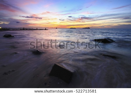 Amazing seascape during dramatic  sunset with slow shutter technique