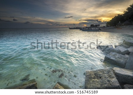 Amazing seascape view golden sunrise in Mabul island with crystal clear water sea