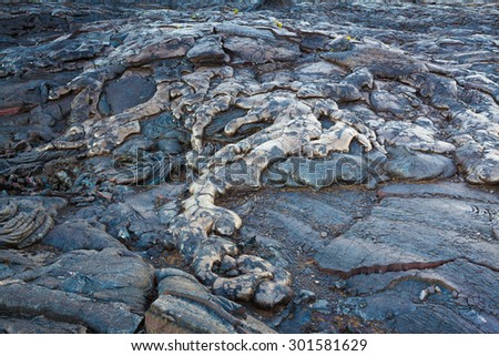 Amazing shapes and patterns of molten cooled lava landscape in the evening in Hawaii Volcanoes National Park, Big Island, Hawaii - stock photo
