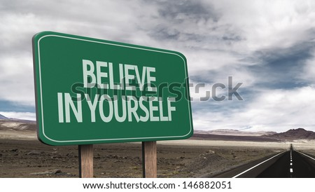Amazing sign on the road with the message - Believe in Yourself - stock photo