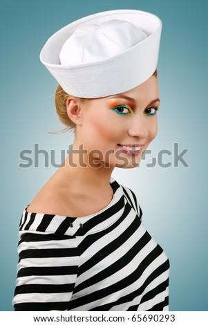 Amazing smiling young girl in sailor's cap - stock photo