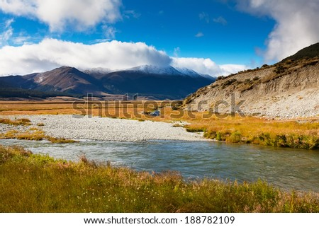 Amazing snowy mountains and river water in New Zealand. - stock photo
