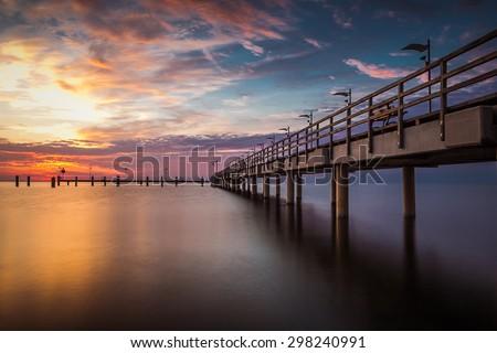 Amazing Ssnrise at the beach, Machalinki Poland .Vintage sunrise seascape. Polish seashore. - stock photo