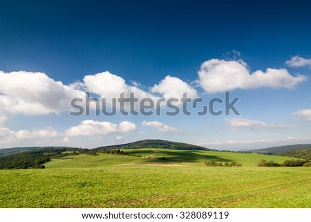 Amazing summer countryside with green pasture and blue sky with clouds - Czech Republic, Europe - stock photo