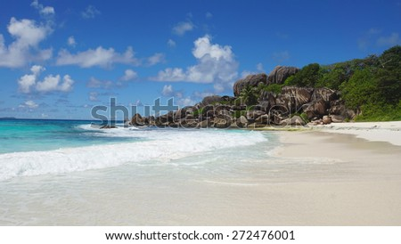 amazing summer day at tropical beach on la digue