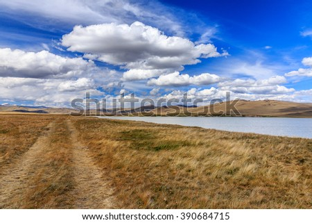 Amazing summer landscape with mountains, river and blue sky with clouds. Plateau Ukok - stock photo
