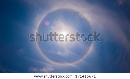 Amazing sun halo phenomenon - stock photo