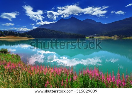 Amazing sunny day at Champferersee lake in the Swiss Alps. Silvaplana village, Switzerland, Europe. - stock photo