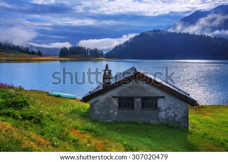 Amazing sunny morning at Champferersee lake in the Swiss Alps. Silvaplana village, Switzerland, Europe.