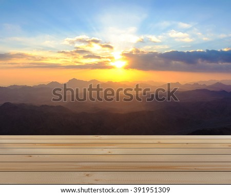 Amazing Sunrise at Moses (Sinai) Mountain and wooden floor - stock photo