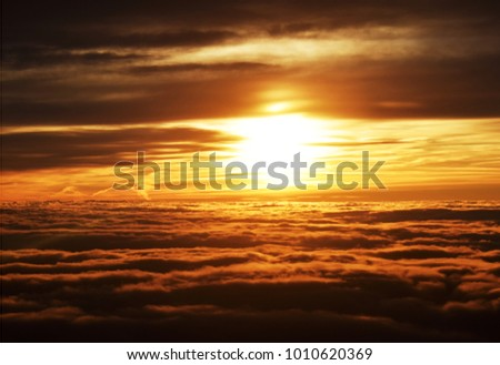 Amazing Sunrise Picture of Sun and Clouds taken from the Plane