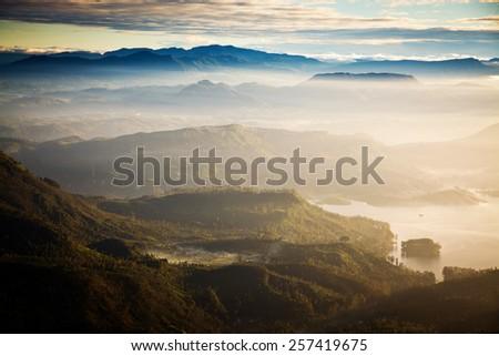 Amazing sunrise seen from Adam's Peak - sacred buddhist place. Sri Lanka - stock photo