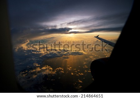 Amazing sunrise view from plane on sun and clouds - stock photo