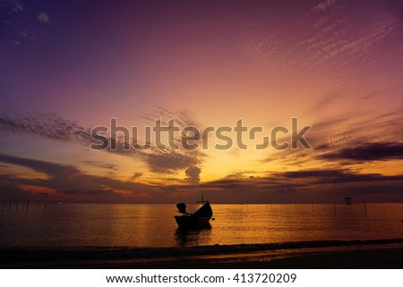 Amazing sunrise with silhouette image fishing boat view as a foreground.Soft focus due to long exposure shot.Nature composition:Ideal use for background. - stock photo
