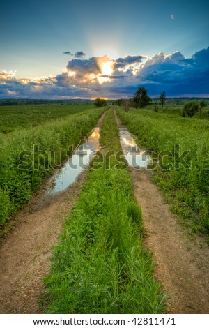 amazing sunset above the filed - stock photo