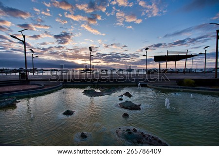 Amazing sunset along the port in San Cristobal island, Galapagos, Ecuador - stock photo