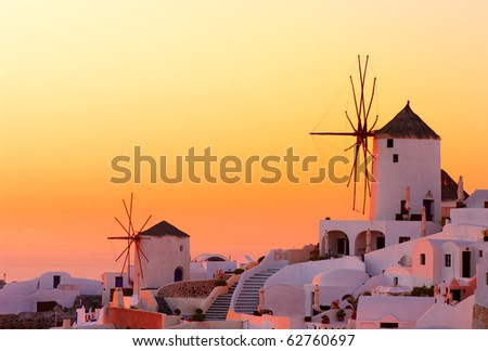 Amazing sunset at Oia village in Santorini island. - stock photo