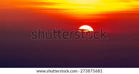 Amazing sunset behind the clouds - stock photo
