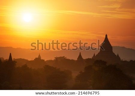 Amazing sunset colors and silhouettes of ancient Buddhist Temples at Bagan Kingdom, Myanmar (Burma). Travel landscape and destinations - stock photo