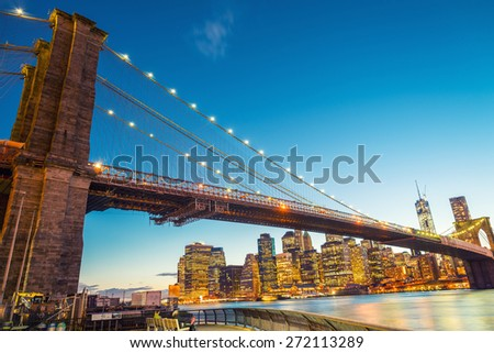 Amazing sunset colors over Brooklyn Bridge in New York. - stock photo