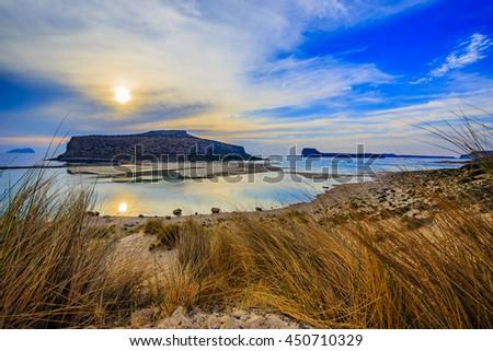 Amazing sunset of Balos Lagoon and Gramvousa island on Crete, Greece  - stock photo