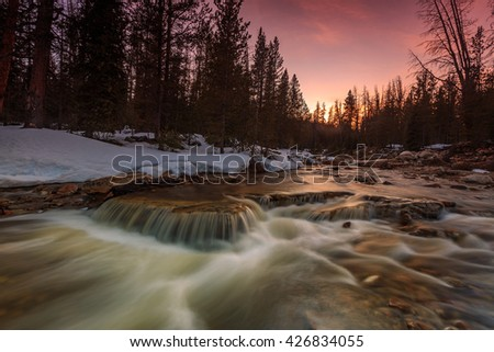 Amazing sunset on a river in the Uinta Mountains, Utah, USA. - stock photo