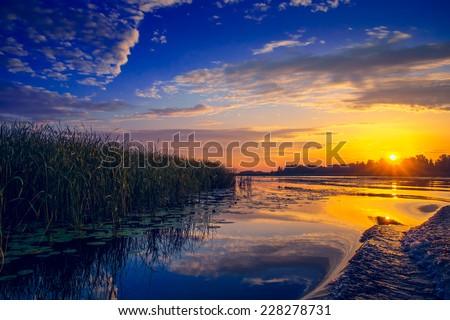 Amazing sunset over lake. Ukraine - stock photo
